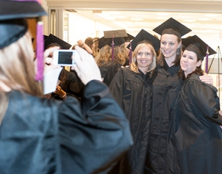Grads prepare for Commencement in 2012. Photo by John Welsh