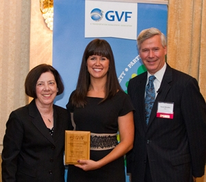 GVF Assistant Director Maureen Farrell and Action News Meteorologist David Murphy present Dr. Celeste Schwartz, MCCC vice president for Information Technology and College Services, with a platinum level sustainability award. Photo courtesy of GVF