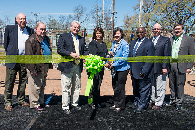Pictured cutting the ribbon for the wind turbines are (from left) MCCC Trustees Andrew Cantor and Ed Mullin, MCCC Trustee Chairman Michael D'Aniello, Pottstown Borough Mayor Sharon Thomas, MCCC President Dr. Karen A. Stout, MCCC West Campus Vice President Dr. Steady Moono, Pottstown Borough Council President Stephen Toroney, and Pa. Representative Mark Painter. Photo by Sandi Yanisko