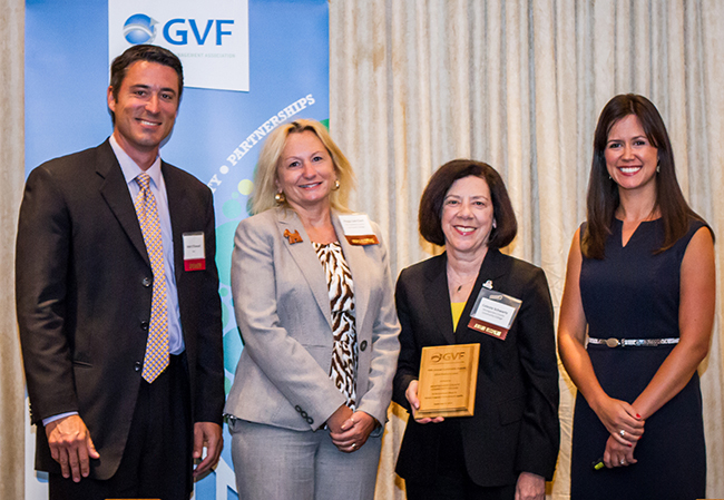 GVF Assistant Director Maureen Farrell (far right) and Action News Anchor Matt O'Donnell (far left) present (from left) Peggy Lee-Clark, MCCC executive director of government relations, and Dr. Celeste Schwartz, MCCC vice president for information technology and college services, with a platinum level sustainability award. Photo courtesy of GVF