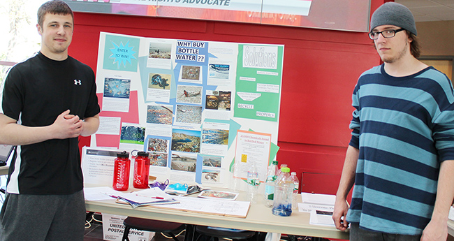 Eco 117 students present their findings during the College's 2014 Earth Day celebration. Photo by Alana J. Mauger